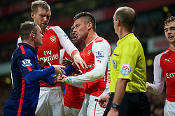 LONDON, ENGLAND - Saturday, November 22, 2014: Arsenal's Oliver Giroud clashes with Manchester United's Wayne Rooney during the Premier League match at the Emirates Stadium. (Pic by David Rawcliffe/Propaganda)