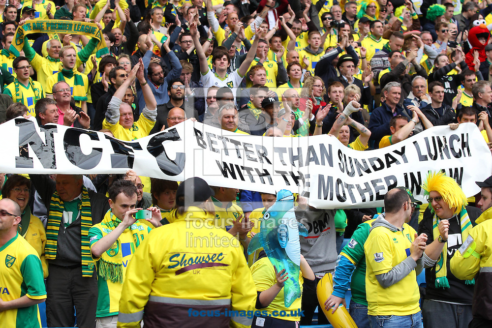 Picture by Paul Chesterton/Focus Images Ltd +44 7904 640267.The Norwich fans celebrate victory at the end of the Barclays Premier League match at The Etihad Stadium, Manchester.