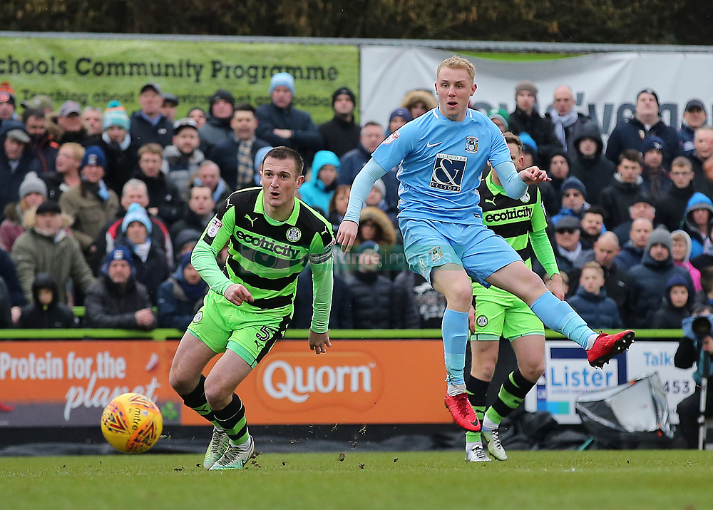 Coventry City's Jack Grimmer sends a low cross into the Forest Green Rovers area