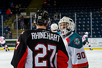 KELOWNA, CANADA - JANUARY 4:  Roman Basran #30 of the Kelowna Rockets stands on the ice speaking with Rhett Rhinehart #27 of the Prince George Cougars during warm up on January 4, 2019 at Prospera Place in Kelowna, British Columbia, Canada.  (Photo by Marissa Baecker/Shoot the Breeze)