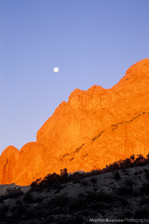 Full moon and morning alpenglow on North Gateway Rock, Garden of the Gods Park, Colorado Springs, Colorado