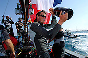 Emirates Team New Zealand helmsman Dean Barker with a bottle of Moet Champagne during celebrations aboard NZL92 after their 5 - 0 win of the Louis Vuitton Cup finals. 6/6/2007