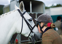 © Licensed to London News Pictures.29/08/15<br /> Bilsdale, UK. <br /> <br /> A rider giver her horse a kiss during the 105th Bilsdale Country Show in North Yorkshire.<br /> <br /> Photo credit : Ian Forsyth/LNP
