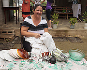 woman cleaning her silverware and dishes