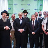 London, UK - 7 August 2014: The Mayor Boris Johnson poses for pictures with Rabbi Oscher Schapiro and members of the  Orthodox Jewish community in Stamford Hill, London