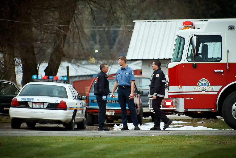Firefighters prepare to leave the scene of a suicide Wednesday on the 6700 block of Valley Street in Dalton Gardens. A Kootenai County Sheriff deputy attempted to pull over Robert J. Kilborn for having a loud muffler when he pulled into a friend's driveway and shot himself.