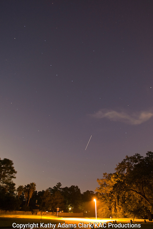 International Space Station flying over a residential area in The Woodlands, Texas, on May 10, 2009. Near Houston.