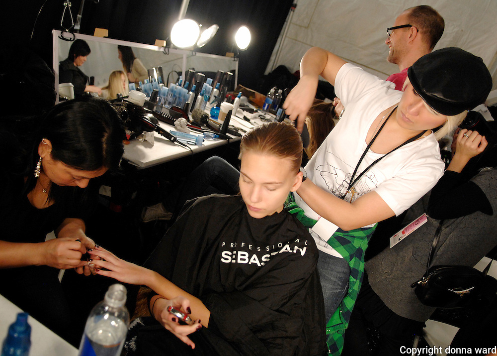 Model prepares backstage at Charlotte Ronson show.