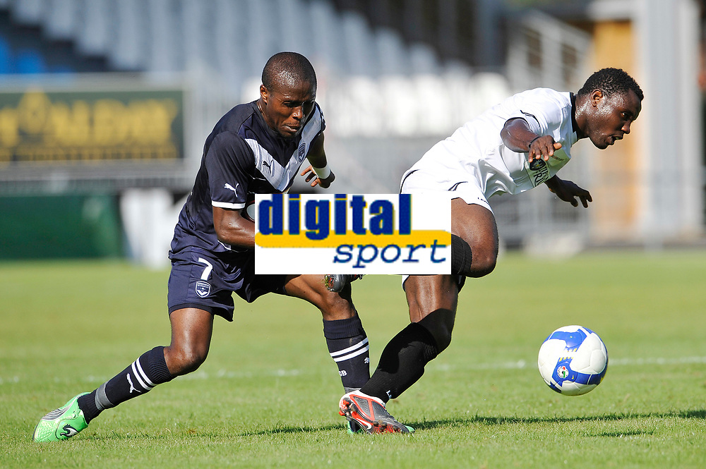 FOOTBALL - FRIENDLY GAMES 2011/2012 - BORDEAUX v UDINESE  - 20/07/2011 - PHOTO GUY JEFFROY / DPPI - KWADWO ASANOAH (UDI) / LANDRY NGUEMO (BOR)