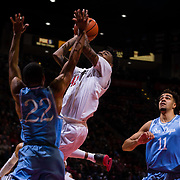 05 December 2018: San Diego State Aztecs guard Jeremy Hemsley (42) attempts a shot under the basket while being defended by San Diego Toreros guard Isaiah Wright (22) in the second half. The Aztecs lost to the Toreros 73-61 at Viejas Arena.