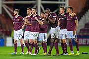 The Hearts team watch as Michael Smith (#2) of Heart of Midlothian FC scores his penalty during the penalty shoot out at the end of Betfred Scottish Football League Cup quarter final match between Heart of Midlothian FC and Aberdeen FC at Tynecastle Stadium, Edinburgh, Scotland on 25 September 2019.