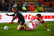 Cauley Woodrow of Barnsley (9) and Andrew Butler of Doncaster Rovers (6) come together during the EFL Sky Bet League 1 match between Doncaster Rovers and Barnsley at the Keepmoat Stadium, Doncaster, England on 15 March 2019.