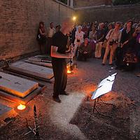 "VENICE, ITALY - OCTOBER 01:  Clarinet Dirk Descheemaeker performs on Igor Stravinskij grave at San Michele, Venice grave yard, part of the ""Vogata Rituale - Cultura in Memoriam"" on October 1, 2011 in Venice, Italy.  Vogata Rituale - Cultura in Memoriam is part of the 55. Festival Internazionale di Musica Contemporanea organised by the Biannale."
