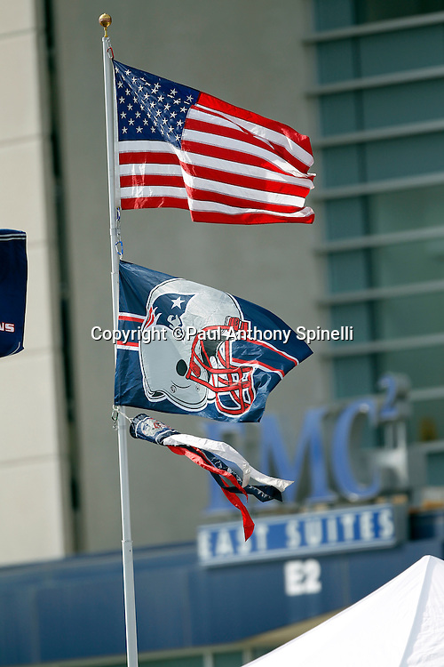 Flags fly for the New England Patriots NFL regular season week 3 football game against the Buffalo Bills on September 26, 2010 in Foxborough, Massachusetts. The Patriots won the game 38-30. (©Paul Anthony Spinelli)
