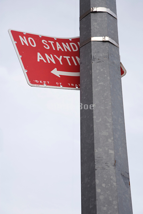 a bent No standing traffic sign