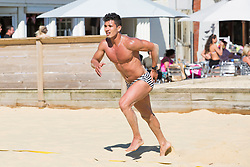 © Licensed to London News Pictures. 25/05/2017. Brighton, UK. FELIPE from Brighton enjoys the hottest day of the year so far by playing a game of beach football in brighton and Hove. Photo credit: Hugo Michiels/LNP