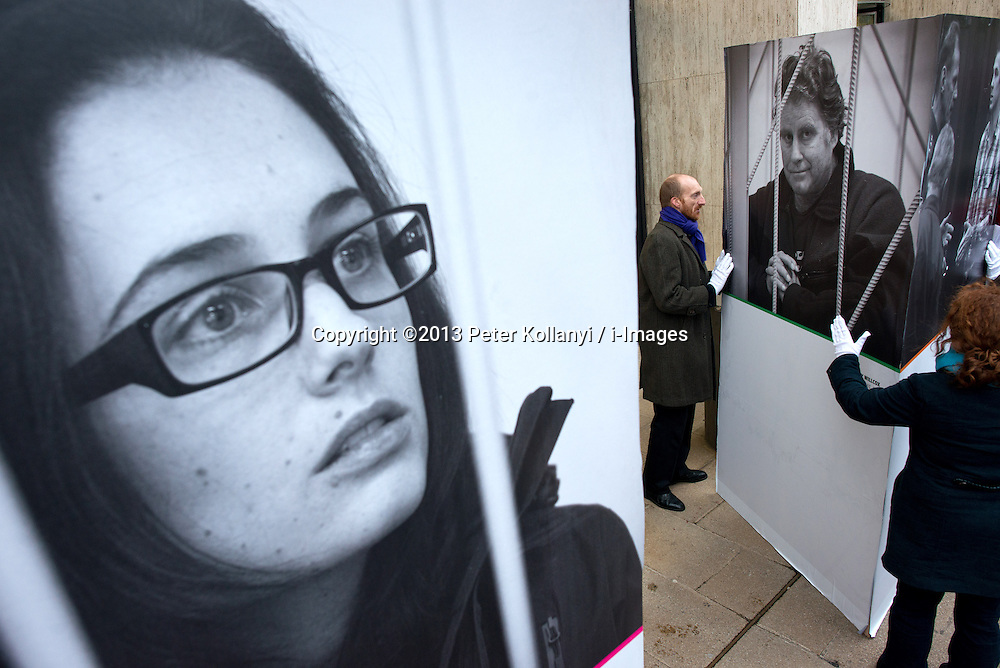 Greenpeace supporters set up an exhibition at the Shell centre in London to protest against Arctic drilling .The group unveiled giant portraits of the 28 activists and two journalists detained in Russia as three British protesters were granted bail by authorities, Thursday, 21st November 2013. Picture by Peter Kollanyi / i-Images