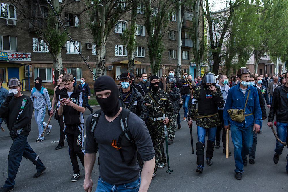 Pro-Russian protesters march toward the military prosecutor's office on May 4, 2014 in Donetsk, Ukraine. Cities across Eastern Ukraine have been overtaken by pro-Russian protesters in recent weeks, leading the Ukrainian military to respond with force in some areas.