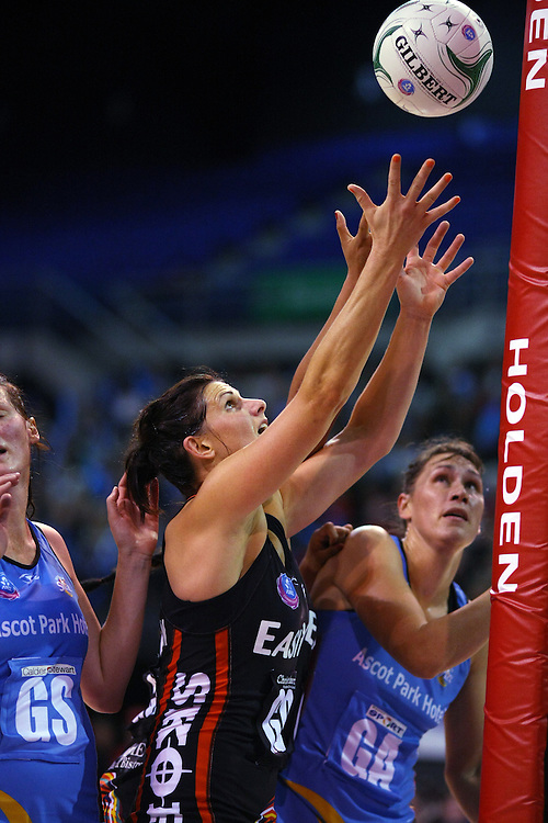 Tactix's Anna Galvan reaches for a rebound against the Southern Steel in the ANZ Netball Championship, CBS Arena, Christchurch, New Zealand, Sunday, April 15, 2012. Credit:SNPA / Dianne Manson