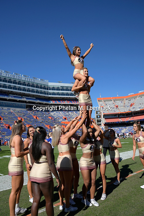 The Florida State cheerleaders perform before an NCAA college football game against Florida Saturday, Nov. 25, 2017, in Gainesville, Fla. (Photo by Phelan M. Ebenhack)