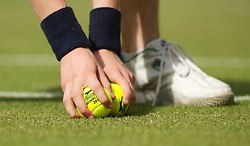 LONDON, ENGLAND - Wednesday, June 30, 2010: A ball-boy with Slazenger tennis balls during the Gentlemen's Singles Quarter-Final on day nine of the Wimbledon Lawn Tennis Championships at the All England Lawn Tennis and Croquet Club. (Pic by David Rawcliffe/Propaganda)