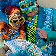 Mermaid Parade couple posing for the camera wearing colorful costumes  before the start of the parade in Coney Island.