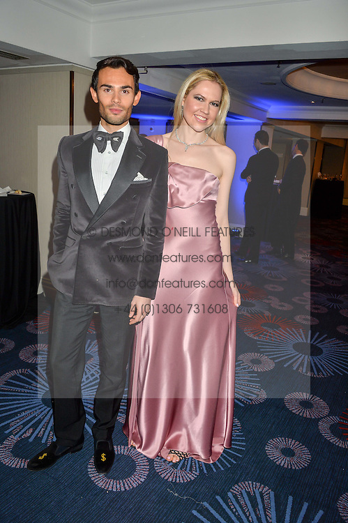 MARK-FRANCIS VANDELLI and ALINA KLIOUTCHKINA at the Chain of Hope Ball held in aid of the charity Chain of Hope, founded by Professor Sir Magdi Yacoub which organises volunteer teams worldwide to operate on children suffering from life-threatening heart diseases, held at the Grosvenor House Hotel, Park Lane, London on 20th November 2015.