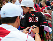 Jul. 28, 2012; Flagstaff, AZ, USA; Arizona Cardinals quarterback Kevin Kolb (4) signs the jersey of a fan prior to  training camp practice on the campus of Northern Arizona University.  Mandatory Credit: Jennifer Stewart-US PRESSWIRE.
