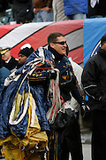 6 Dec 2008: A Navy Leap Frog carries his parachute as he walks off the field before the Army / Navy game December 6th, 2008. At Lincoln Financial Field in Philadelphia, Pennsylvania.