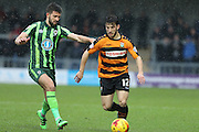 George Francomb of AFC Wimbledon and Luke Gambin of Barnet FC during the Sky Bet League 2 match between Barnet and AFC Wimbledon at Underhill Stadium, London, England on 20 February 2016. Photo by Stuart Butcher.