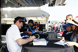 April 13, 2018 - Long Beach, California, United States of America - April 13, 2018 - Long Beach, California, USA: Scott Dixon (9) and Ed Jones (10) sign autographs for fans following practice for the Toyota Grand Prix of Long Beach at Streets of Long Beach in Long Beach, California. (Credit Image: © Justin R. Noe Asp Inc/ASP via ZUMA Wire)