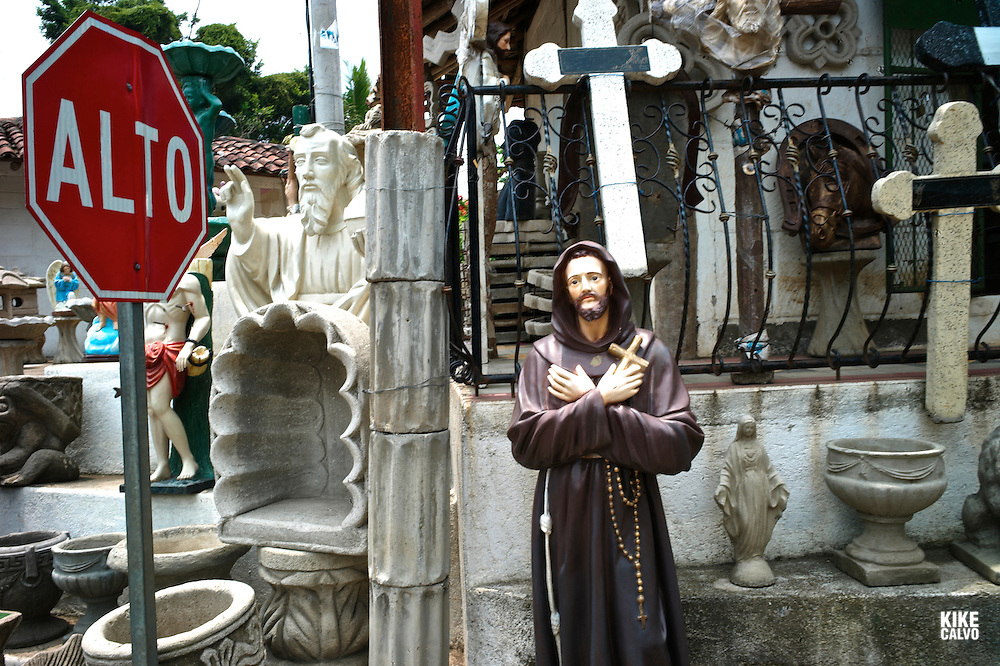 "Religious sculptures and icons at the Masaya Road. Known as ""The Cradle of Nicaraguan Folklore"", Masaya is a great place to buy Nicaraguan handicrafts."