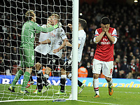 Football - Premier League - Arsenal v Fulham<br />Mikel Arteta puts his head in his hands after missing last minute penalty