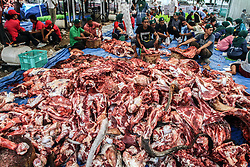 September 1, 2017 - Medan, North Sumatra, Indonesia - Indonesian Muslims slaughter the beef that is distributed to the poor during Eid al-Adha celebrations outside the Mosque on September 1, 2017 in Medan, Indonesia. Muslims in Indonesia celebrate Eid al-Adha, the 'Feast of Sacrifice', which marks the end of an annual pilgrimage or pilgrimage to the Saudi holy city of Mecca and remembers Abraham's readiness to sacrifice his son to God. (Credit Image: © Ivan Damanik via ZUMA Wire)