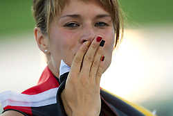Germany's Carolin Nytra celebrates her second place in the women's 100m hurdles final at the 2010 European Athletics Championships at the Olympic Stadium in Barcelona on July 31, 2010. (Photo by Vid Ponikvar / Sportida)
