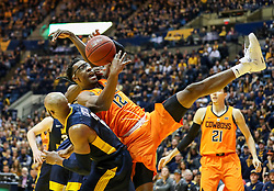 Feb 10, 2018; Morgantown, WV, USA; Oklahoma State Cowboys forward Cameron McGriff (12) attempts to grab a rebound during the first half against the West Virginia Mountaineers at WVU Coliseum. Mandatory Credit: Ben Queen-USA TODAY Sports