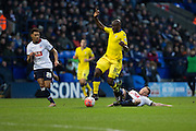 Bolton Wanderers midfielder Jay Spearing challenges Souleymane Doukara of Leeds United during the The FA Cup fourth round match between Bolton Wanderers and Leeds United at the Macron Stadium, Bolton, England on 30 January 2016. Photo by Simon Brady.