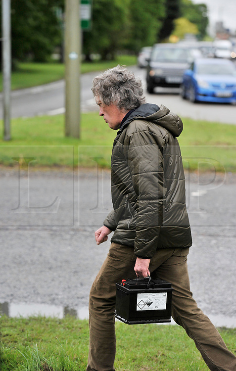 © Licensed to London News Pictures. 08/05/2014. Burford, Oxfordshire. JAMES MAY broken down on the Burford roundabout filming the very last BBC Top Gear in May 2014. The show is to be aired on BBC2  on Sunday 28th June 2015. Photo credit : MARK HEMSWORTH/LNP