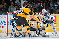 KELOWNA, CANADA - MAY 13: Jordan Papirny #33 of Brandon Wheat Kings makes a save on a shot by Gage Quinney #20 of the Kelowna Rockets during first period on May 13, 2015 during game 4 of the WHL final series at Prospera Place in Kelowna, British Columbia, Canada.  (Photo by Marissa Baecker/Shoot the Breeze)  *** Local Caption *** Jordan Papirny; Gage Quinney;