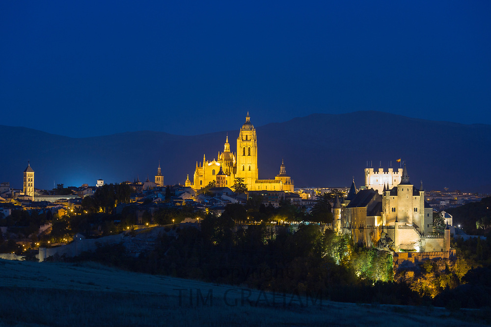 Famous spectacular view of Alcazar Castle - palace and fortress which inspired Disney castle, and Cathedral in Segovia, Spain