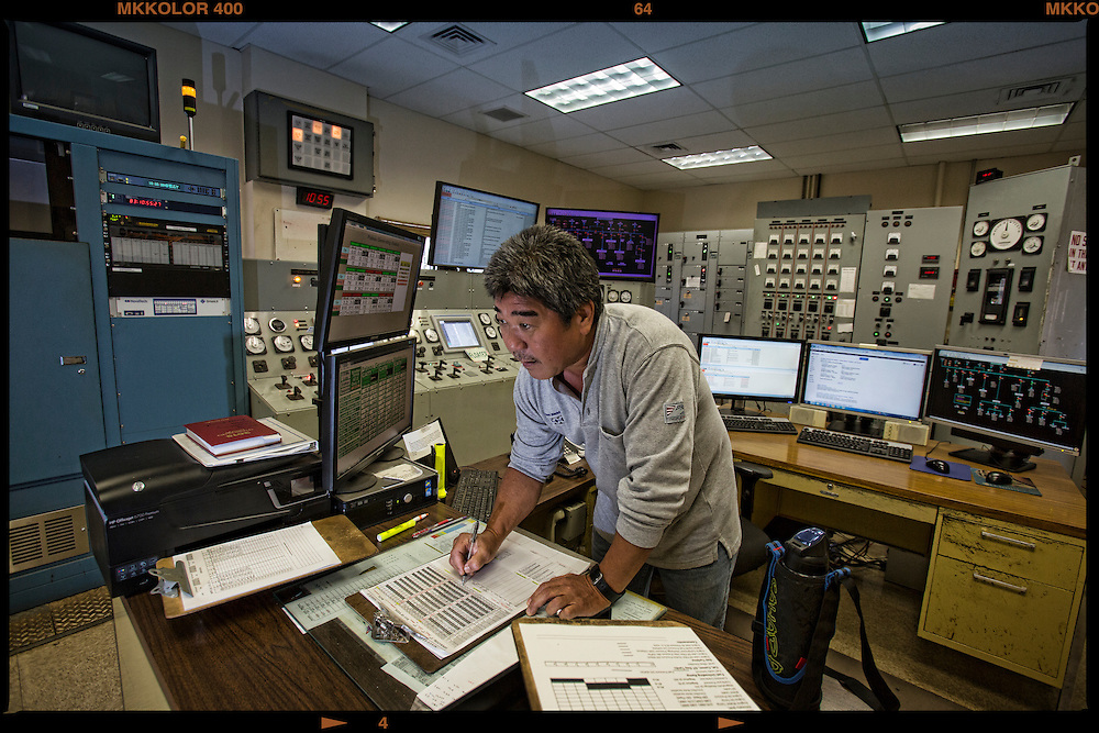 Todd Tamanaha, Chief Operator for 12 years checks the screen for in the MECO Molokai power plant control room.