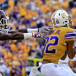 Sep 17, 2016; Baton Rouge, LA, USA;  LSU Tigers wide receiver D.J. Chark (82) catches a touchdown over Mississippi State Bulldogs defensive back Jamoral Graham (9) during the first quarter of a game at Tiger Stadium. Mandatory Credit: Derick E. Hingle-USA TODAY Sports