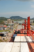 Upper view of containers cargo ship at Miraflores Locks. Panama Canal, Panama City, Panama, Central America.
