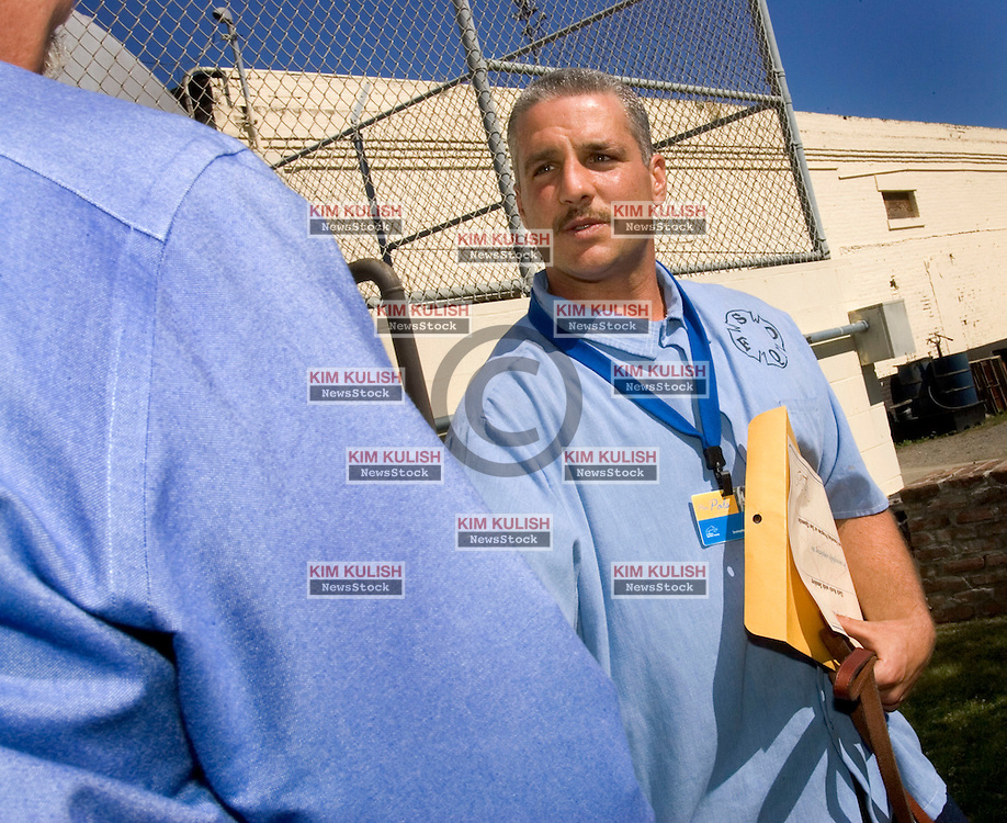 "Prisoner Zachary Roth is thanked for his training efforts with  ""Smokey"" during a  graduation ceremony.  Inmates at San Quentin,  one of California's most notorious prisons, participate in the ""Pen Pals"" program training homeless dogs for adoption. The innovative program partners the prison with the Marin Humane Society to help both the canines and prisoners for life on the outside,  Photo by Kim Kulish"