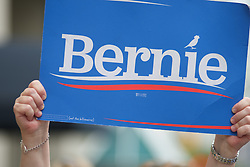 A Bernie2020 campaign sign is help up in the crowd as Sanders co-chair Sen. Nina Turner, joined by local politicians and hospital workers protest the imminent closure of Hahnemann University Hospital at a rally outside the Center City facilities in Philadelphia, PA on July 11, 2019.