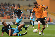 Wolverhampton Wanderers striker Joe Mason takes on Sheffield Wednesday defender Vincent Sasso during the Sky Bet Championship match between Wolverhampton Wanderers and Sheffield Wednesday at Molineux, Wolverhampton, England on 7 May 2016. Photo by Alan Franklin.