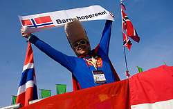 Norwegian Fan as Superman with sign Skiers for children during Flying Hill Individual First Round at 2nd day of FIS Ski Flying World Championships Planica 2010, on March 19, 2010, Planica, Slovenia.  (Photo by Vid Ponikvar / Sportida)