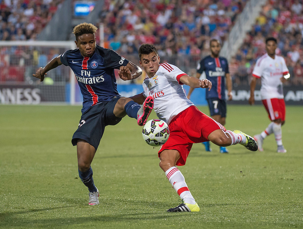 Paris St. Germain's Christopher Nkunku and SL Benfica's Nico Gaitan  in the International Champions Cup in Toronto.