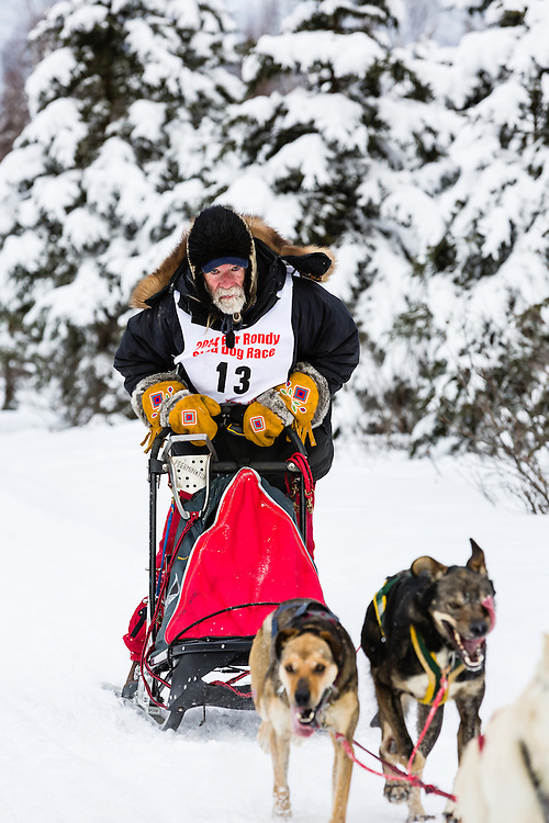 Musher Bill Kornmuller competing in the Fur Rendezvous World Sled Dog Championships at Campbell Airstrip in Anchorage in Southcentral Alaska. Winter. Afternoon.