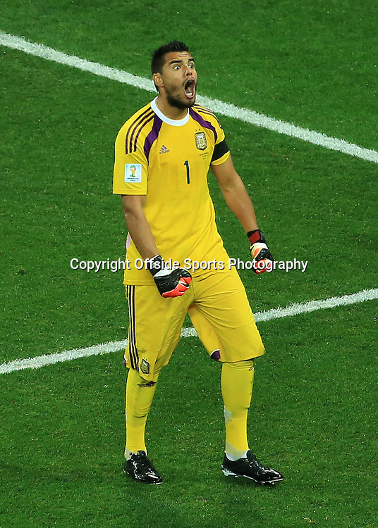9th July 2014 - FIFA World Cup - Semi-Final - Netherlands v Argentina - Argentina goalkeeper Sergio Romero celebrates after making a save during the shootout - Photo: Simon Stacpoole / Offside.